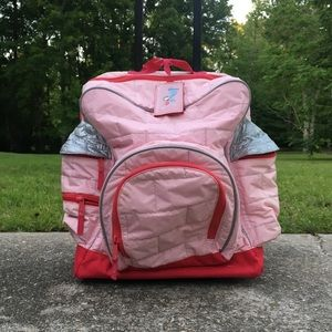Pink castle rolling luggage fit for a princess.